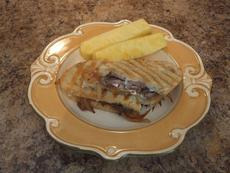 Grilled Flank Steak Sandwiches with Caramelized Onions and Provolone Cheese