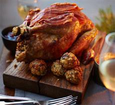 Roast guinea fowl with chestnut, sage & lemon stuffing