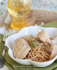 Slow Cooker Honey Dijon Chicken Over Garlic Pasta