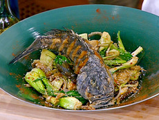 Chinese-Style Whole Fried Black Bass over Wok-Sauteed Bok Choy, Ginger, and Spring Garlic